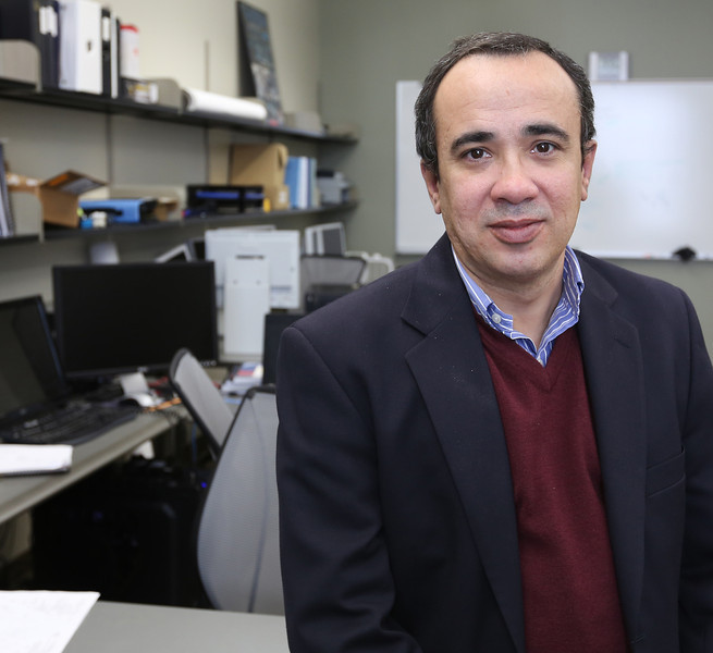 Tulsa University Associate Professor Mauricio Papa pauses for a photo.