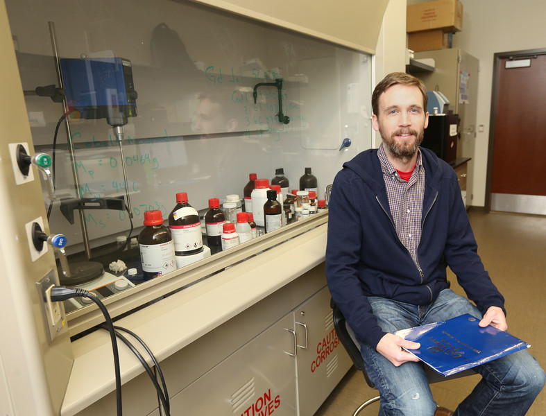 Tulsa University Professor Todd Otanicars in his lab.