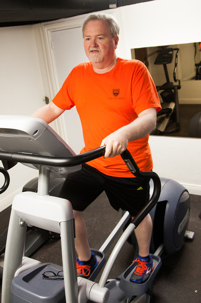 Mitch Kilcrease, director of the OSU student union, working out at the Atherton Hotel gym.