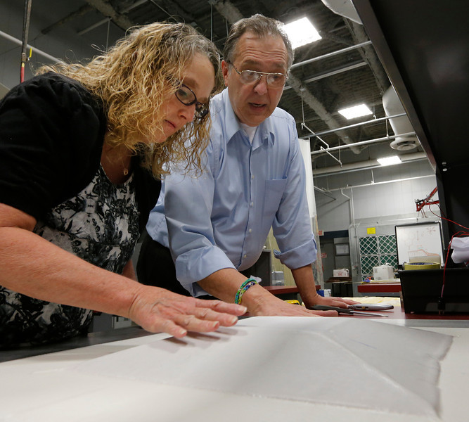 TCC student Dena Sampson and Instructor Donald Hall work to produce a composite aircraft part.