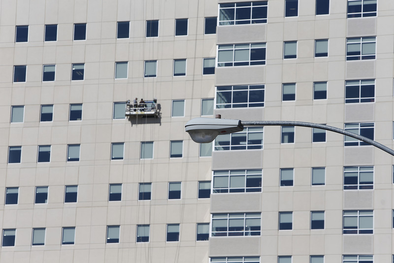 Workmen perform maintenance on the One Place Tower in downtown Tulsa.