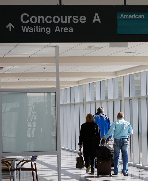 Travelers walk to the Concourse A terminal at the Tulsa International Airport