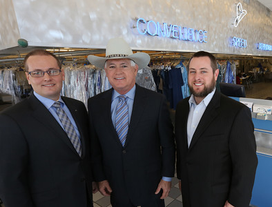 John, Bill and Jim Rothrock pause for a photo at their Broken Arrow Yale cleaners location.