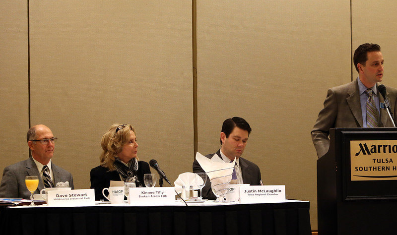 The discussion panel at NAIOP meeting is introduced Wednesday in Tulsa.
