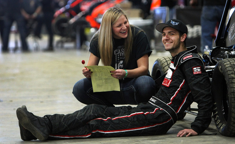 Brooke Rowden gives driver Wes McIntyre a little good humored teasing during the the 28th annual Chili Bowl Nationals Midget races in Tulsa.