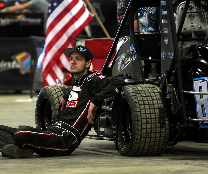 Driver Wes McIntyre of Fresno California relaxes  at the 28th anual Chili Bowl Nationals Midget races in Tulsa.
