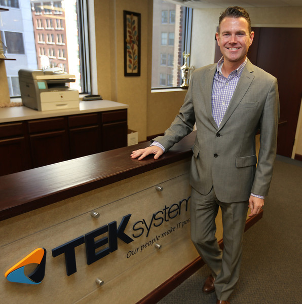 David Izett, Director of Business Operations at TEK Systems, pauses for a photo at the companies downtown Tulsa office.