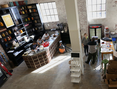 Employees work to get the Folks Urban Market and Pantry in downtown Tulsa ready for their Friday grand opening.