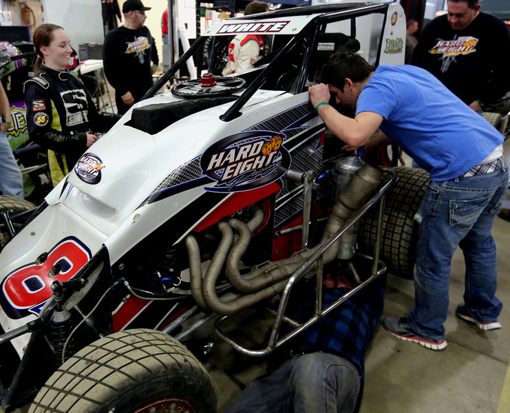 Harli White (L) helps her crew service her car between heats  at the Chili Bowl races in Tulsa.