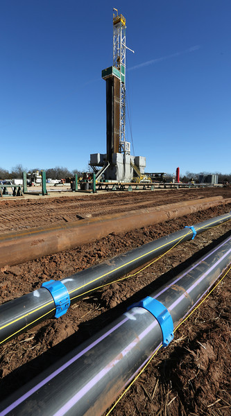 Different pipe lays on the ground near the Cactus 152 well near Perry.  The pipe will be connected to create the Integrated Facility Pipeline.