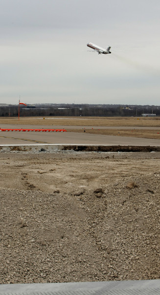Near part of the ongoing runway maintenance an American Airlines flight departs the Tulsa International Airport