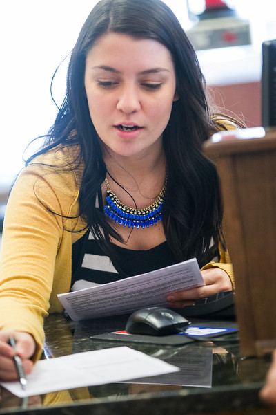 Cierra Nixon helps a customer open a new account at Bank 7 located at NW 63rd and Western in Oklahoma CIty, OK.