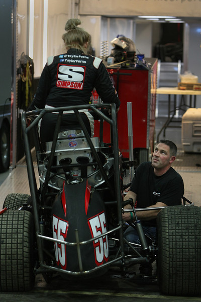 A racer and mechanic work on their race car at the 28th annual Chili Bowl Nationals Midget races in Tulsa.