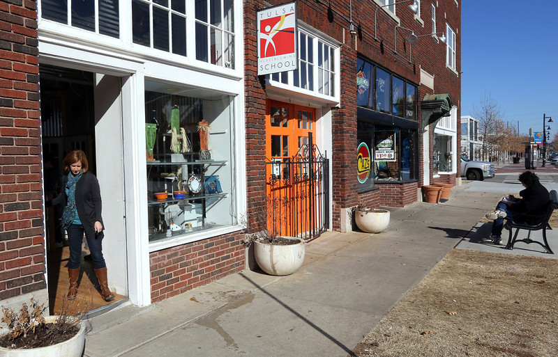 A customer leaves a small shop in the Brady Arts District in Tulsa.  A majority of Oklahoma entrepreneurs responding to an online survey said they had higher revenues during the last half of 2013 and expect even higher revenues in the first half of this year. The survey was operated by the Entrepreneurs' Organization, included 44 Oklahoma companies with at least $1 million in annual revenue.