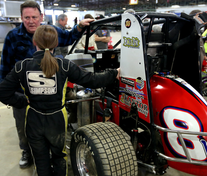 Harli White chats with her crew between heats  at the Chili Bowl races in Tulsa.