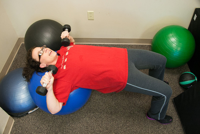 Crystal Peery using the gym provided at Love's Corperate Headquarters in Oklahoma City, OK.