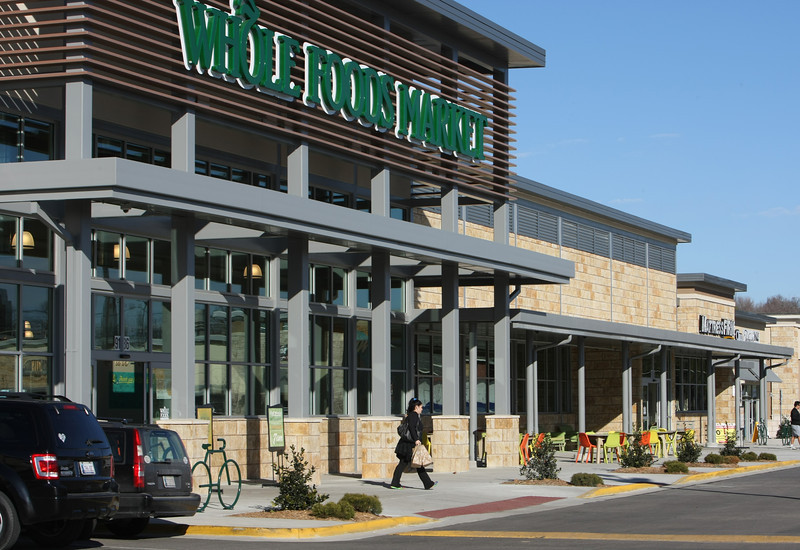 Customers visit the Whole foods store in the Yale Village shopping center in south Tulsa.