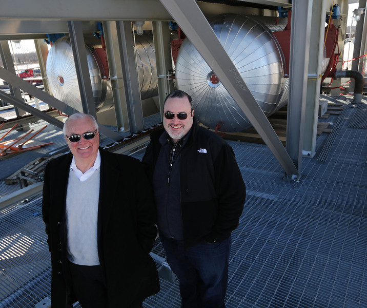 Bevan Houston and Doug Houston, owner and Devco CEO pasue for a  photo in front of a sulfur being constructed for shipment to Iraq.
