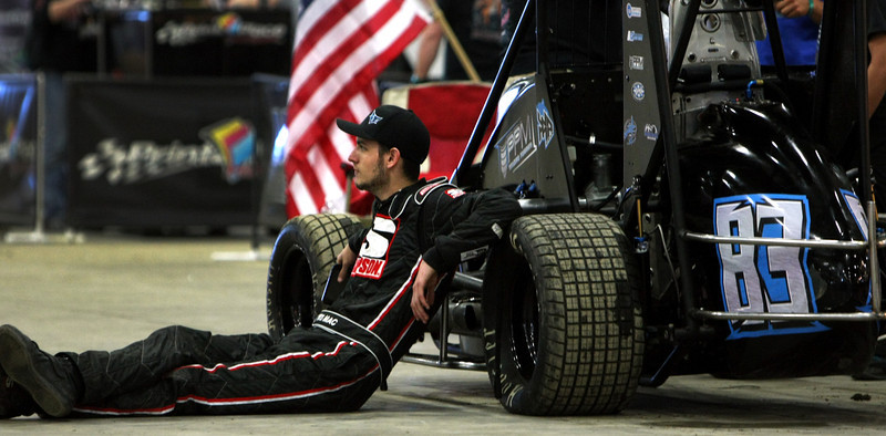 Driver Wes McIntyre of Fresno California relaxes at the 28th annual Chili Bowl Nationals Midget races in Tulsa.