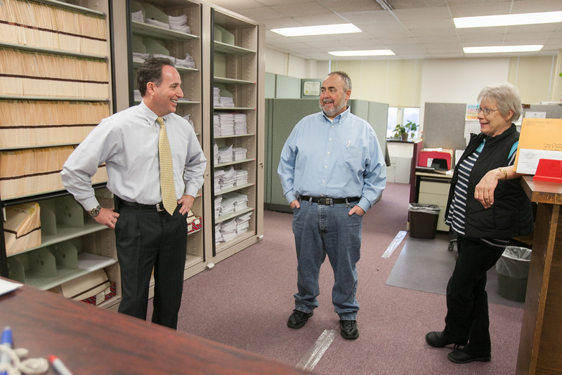 Sam Macaluso (left), the new director of the Oklahoma Corporation Commission's Transportation Division talking with employees in the transportation divsion.