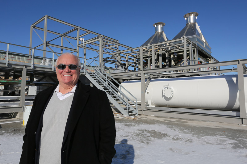 Doug Houston, Devco CEO, pasues for a  photo in front of a sulfur being constructed for shipment to Iraq.