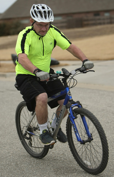 Ray Matlock, ROW Integrity Specialist with Explorer Pipeline, gets in his daily bike ride.