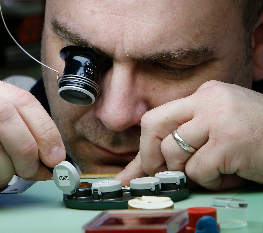 Oklahoma State University Institute of Technology watchmaking student Jeffery Henderson uses a loupe and tweezers to work on a project in class.