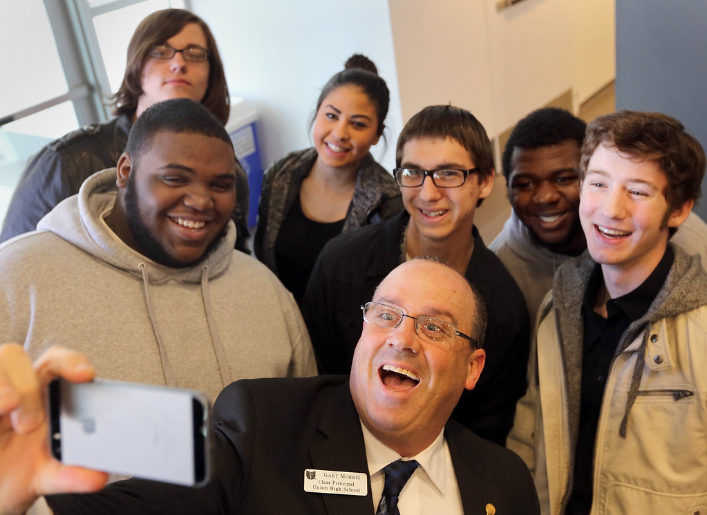 Gart Morris, Class Principle at Union High School, grabs a selfie with the Automotive Mechanic Interns for the city of Tulsa after the STEM Mentoring to the Max meeting in Tuesday morning.