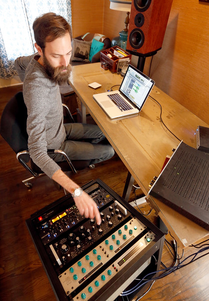 Chris Wylie works on a music track at his home based engineering studio.