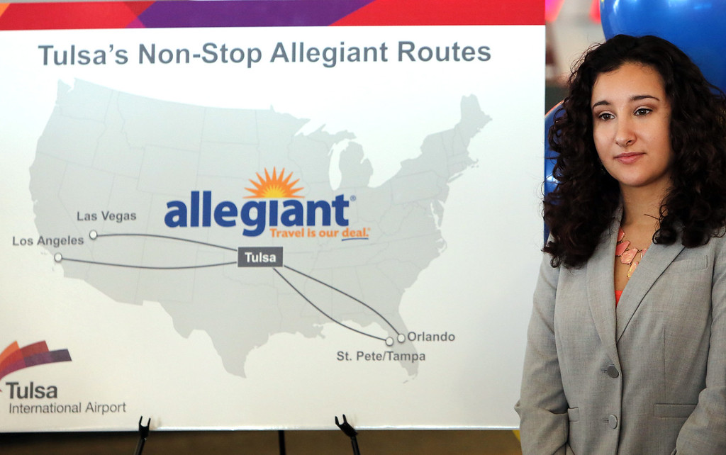Laura Balloter, Public Relations Specialist for Allegiant Airlines, stands besides a sign announcing the airlines  four non-stop flights from Tulsa. <br /> <br /> Year round service to Las Vegas starts April 8th - As low as $65 one way<br /> <br /> Seasonal Service to:<br /> Tampa Bay May 7 - Aug 18  - As low as  $80 one way<br /> Los Angeles June 5 - Aug 18 - As Low as $81 one way