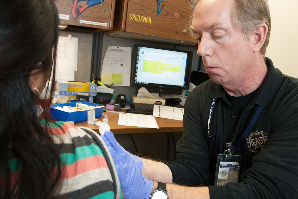 David Legg administers a flu shot at the Oklahoma City County Health Department in Oklahoma CIty.