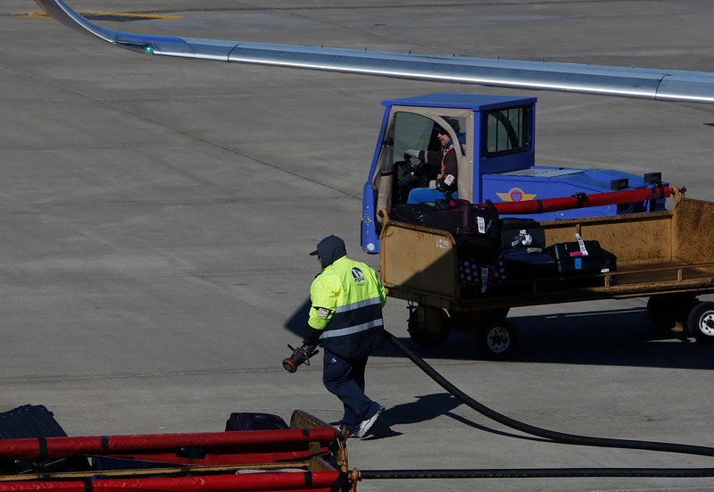 Crewmen service a Southwest Airlines jet at the Tulsa International Airport.