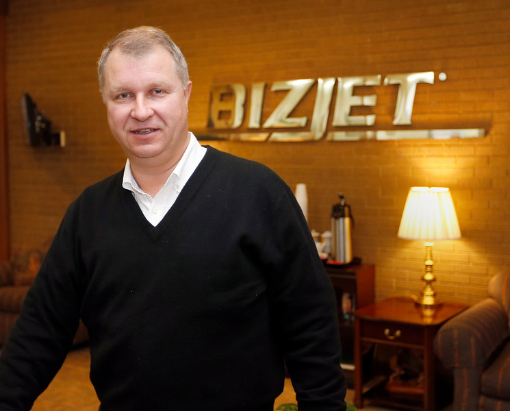 Manfred Gaetner, CEO of BizJet International in Tulsa, pass for a photo.