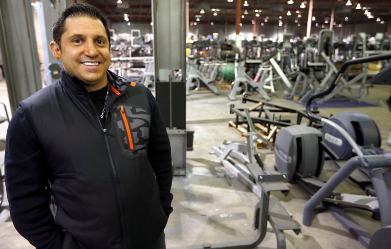 Dean Navab, Sales Manager of Commercial Fitness Concepts, pauses for a photograph in the companies warehouse in Tulsa.