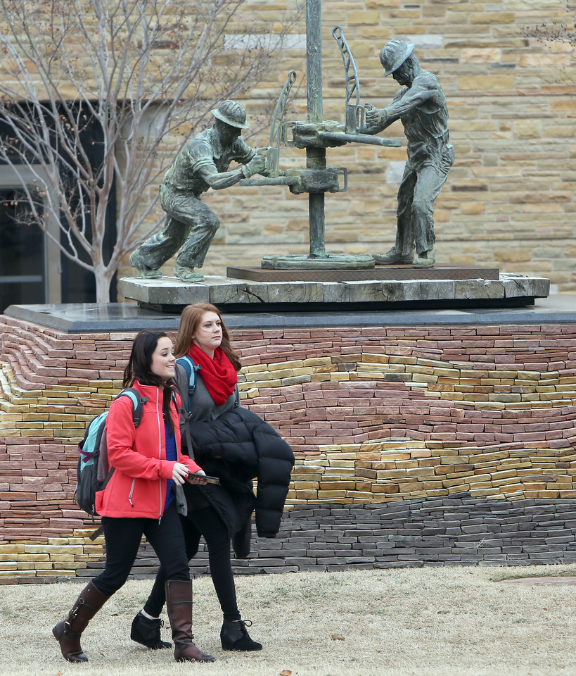 Students cross the Tulsa University campus outside Kiplinger hall Monday.