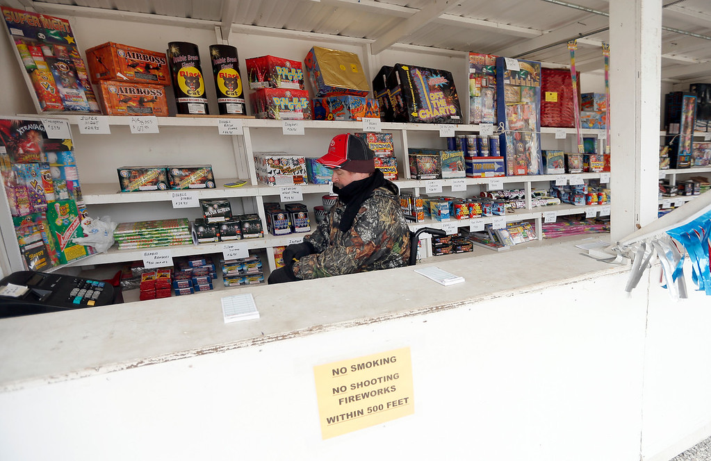 At a fireworks stand in Jenks Aaron Laws readies the inventory for tonights sales.