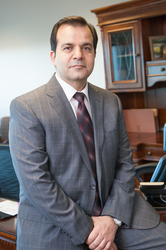 Immigration Attorny Amir Farzaneh at his office in Norman, OK.