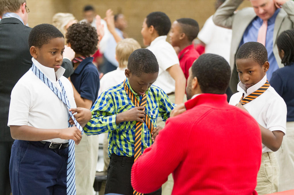 "Sandridge Energy hosted ""Tie A Tie Day"" at FD Moon Academy in Oklahoma City. Men from around the community helped to teach boys in the class how to tie ties and bow ties."