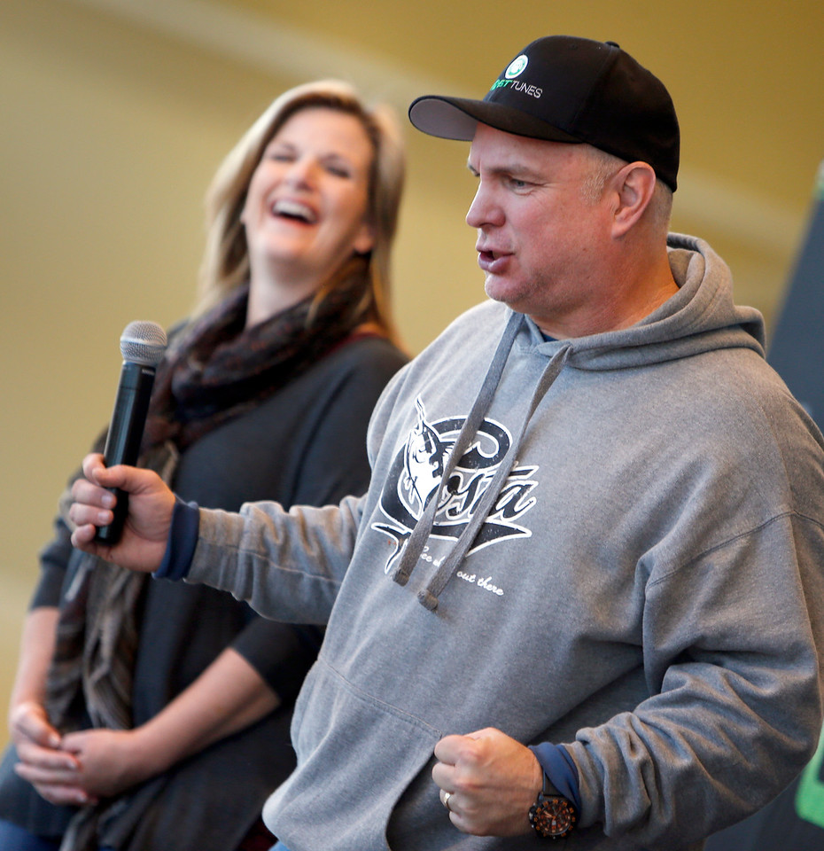 Singers Trisha Yearwood and Garth Brooks answer reporters questions prior to Brooks performance Friday night at the BOK Center in Tulsa.