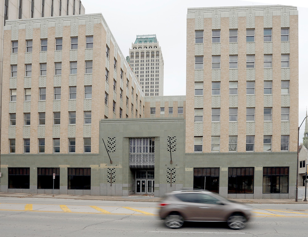A vehicle drives past the Sinclair building in downtown Tulsa.