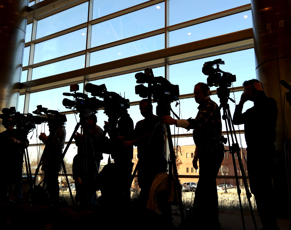 Silhouetted news photographers at the Garth Brooks pre-concert interview.