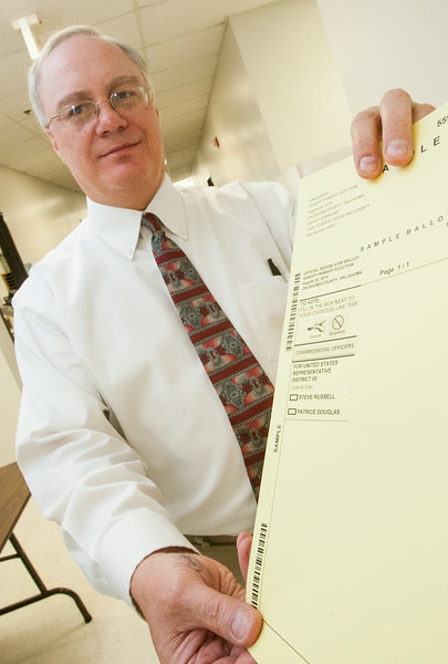 Doug Sanderson holds a sample ballot for the run off race in Oklahoma's 5th Congressional District.
