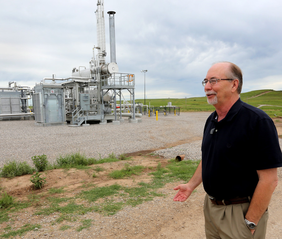 Chaparral Energy Division Operations Manager Larry Brinlee at one of the companies well CO2 injection compressor stations in Osage County.
