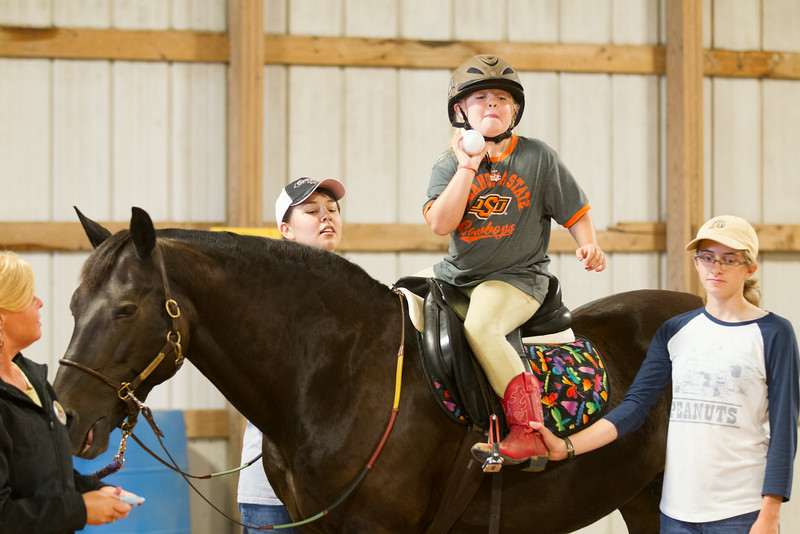 Lily McCutchin-Farmer rides Raven at Sunset Theraputic Riding in Yukon, OK.