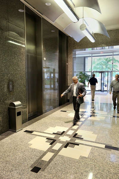 Pedestrian stroll through the lobby of the First Place Tower  in downtown Tulsa.