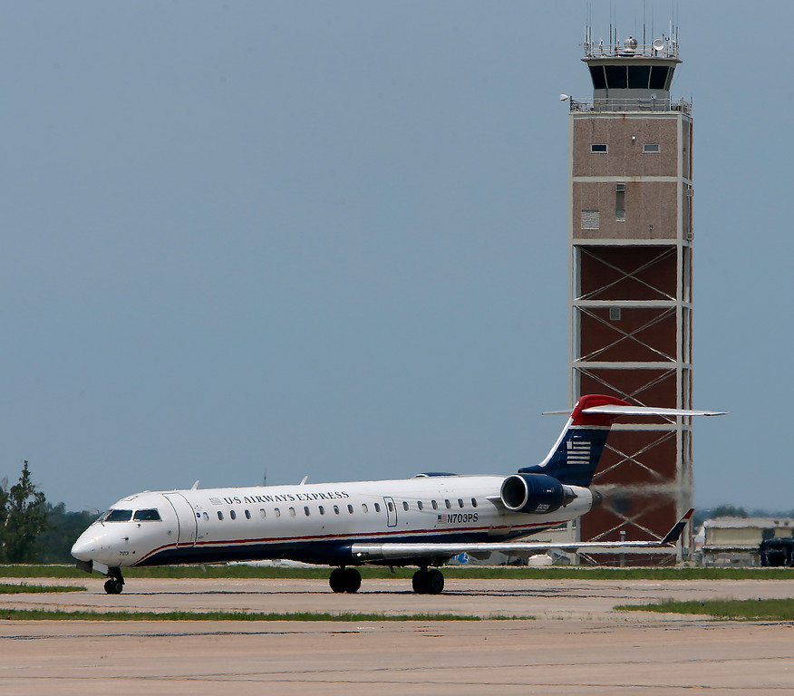 The inaugural aircraft ushering in non-stop American Airlines service to Charlotte taxis past the Tulsa International Airports control tower Wednesday.