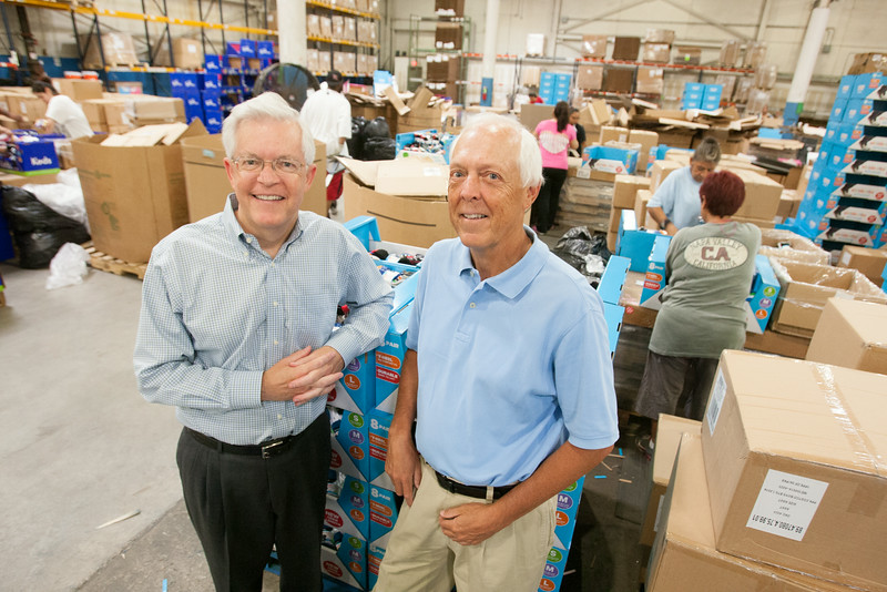 Mark and David McCubbin at McCubbin Hosiery in Oklahoma CIty, OK. In the background workers assemble products for Costco and Sam's Club.