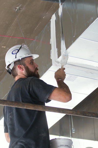 Matt Perdue seals duct work at the new law school building for Oklahoma City University in Oklahoma CIty, OK.