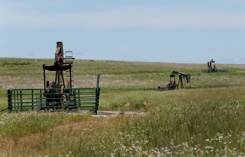 Pump jacks in Osage county.<br /> <br /> oil equipment grassland tall grass prarie