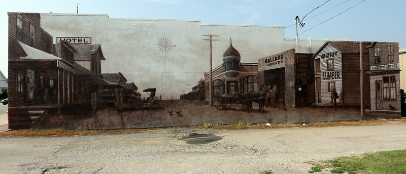 A mural painting of the old main street is on display on the north side of the the Owasso historical museum.